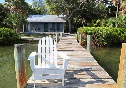 Chair sits on dock leading to Tarpon Cottage at Cabbage Key