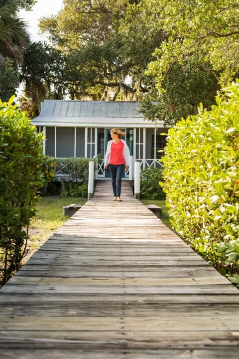 Guest enjoying a morning walk on the Doll House rental cottage dock