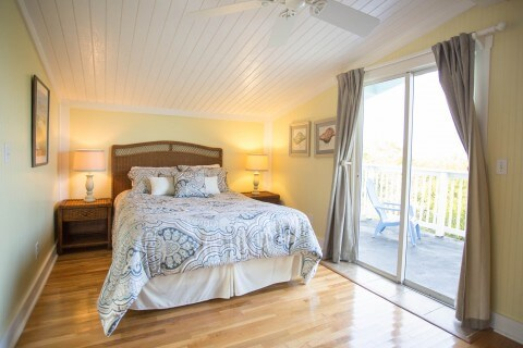 Upstairs Queen bedroom at the Snook Cottage with rooftop deck