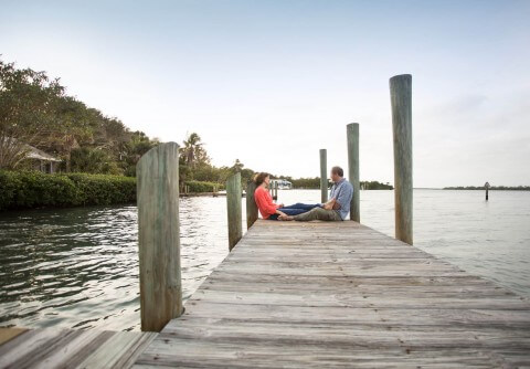 Couple enjoying dockside afternoon at the Cabbage Patch dock