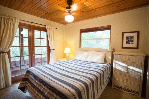 Blue Heron Cottage Queen bed bedroom the Blue Heron has two Queen bedrooms and one bath.