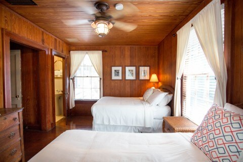 Room number 4 double bed and twin bed bedroom Historic Cabbage Key Inn.